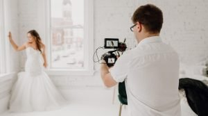 Wedding Videographer filming bride