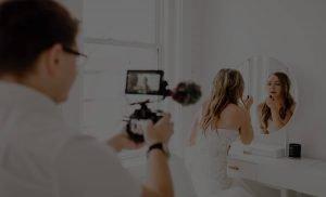 Wedding Videographer filming bride putting on makeup