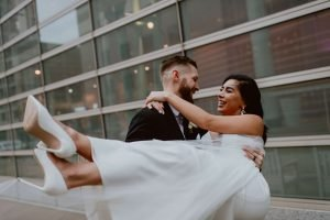 Groom Holding Bride Outside Liberty Tower