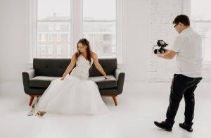 Wedding Videographer filming bride